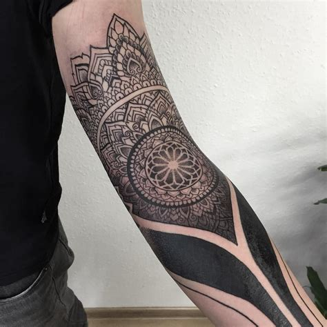 sacred ink tattoo dotwork blackwork arm sleeve geometry