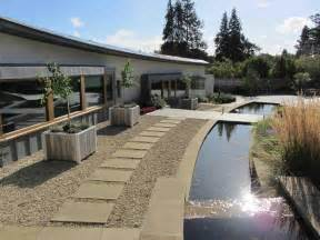 Water feature in large modern country garden design by chameleon