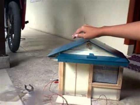Alat Pemberi Pakan Ikan Otomatis Berbasis Arduino tirai dan lu otomatis berbasis mikrokontroler at89s51