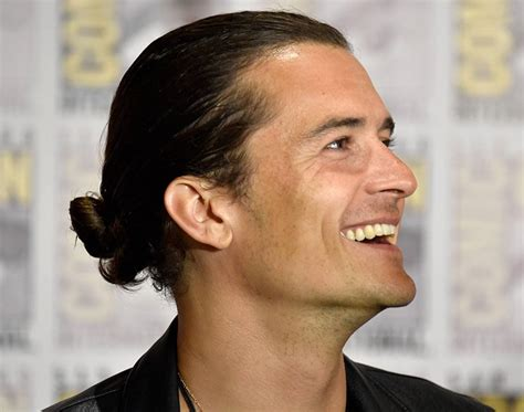 orlando bloom man bun why the man bun is the hairstyle of the moment