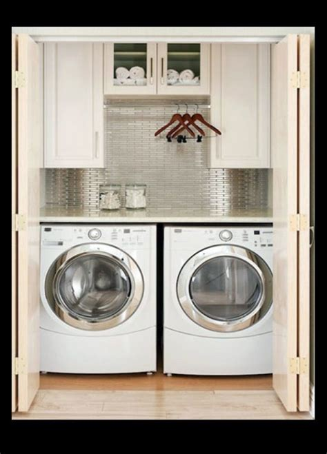 laundry in bathroom laundry in a cupboard designs 1000 ideas about laundry cupboard on pinterest