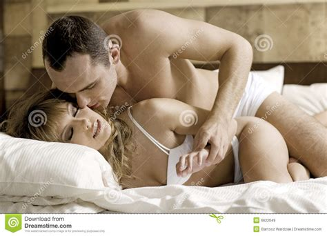 people making out in bed young couple in bed royalty free stock images image 6622049