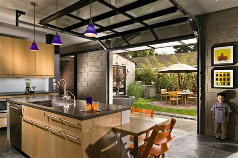 Garage Kitchen by Kitchen With Courtyard Outside Glass Garage Doors
