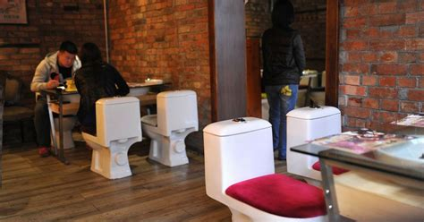 newspaper themed restaurant bowled over diners sit on lavatories at toilet themed