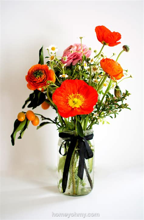 how to arrange flowers flower arranging ranunculus poppies and kumquats