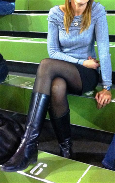 in boots miniskirt and black