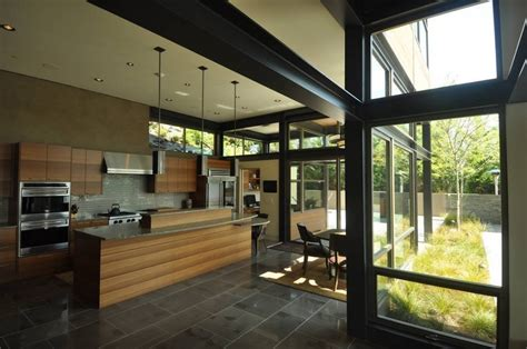steel and glass house designs grand glass lake house with bold steel frame