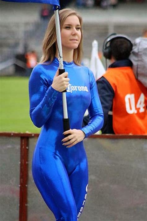 chicas corona blonde woman in shiny blue catsuit at a football match