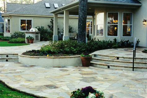 irregular flagstone patio with flagstone capped stucco