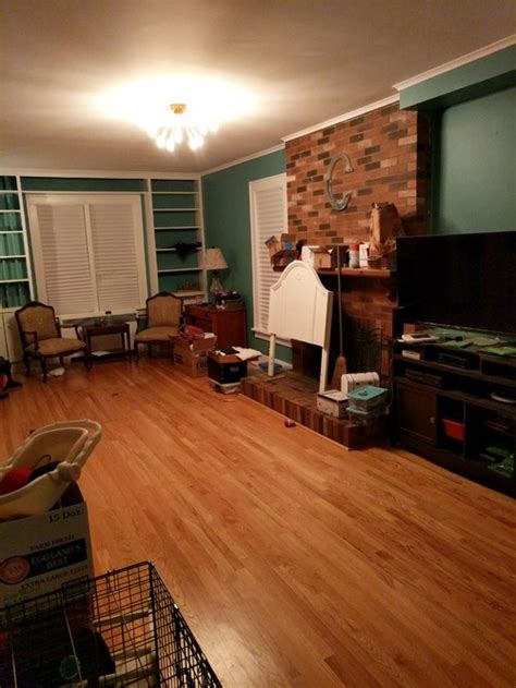 long narrow living room with fireplace in center long very narrow living room with fireplace staircase