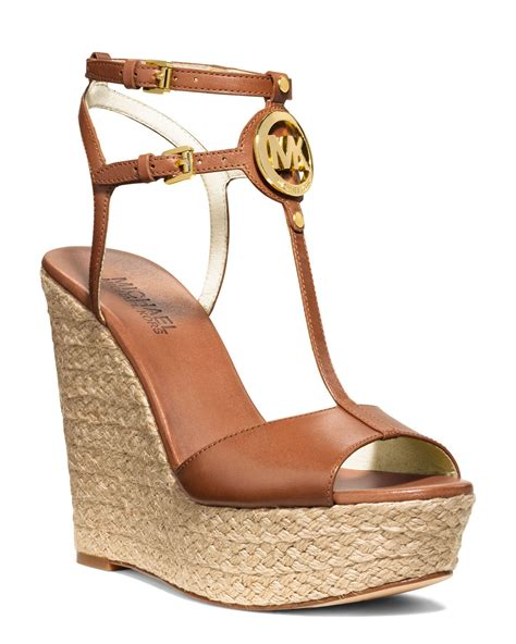 michael kors logo sandals lyst michael kors keely logo wedge sandal in brown