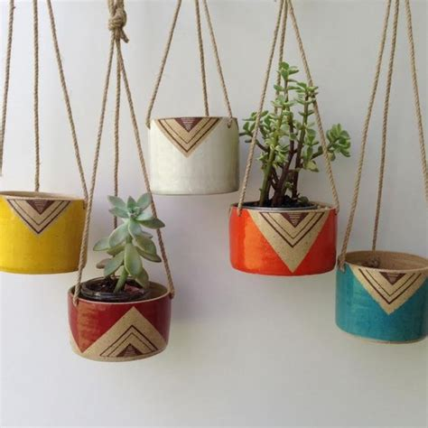 planters hanging planters and painted ceramics on