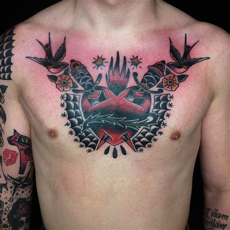 chest tattoo being done chest piece done by karl blom swahili bob s tattoo stockholm