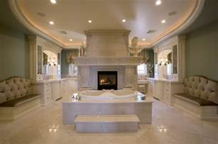 master bath suite with his and vanities and closets
