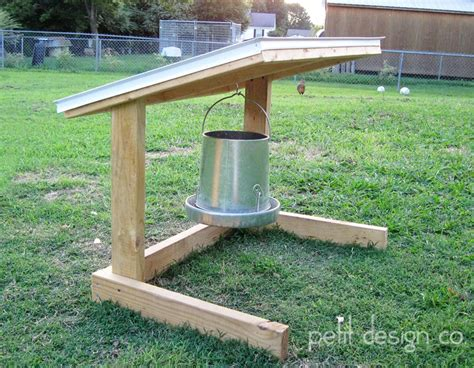 chicken feeder hanger my husband built this to keep the