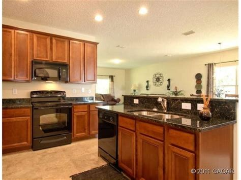 Granite Countertops With Black Appliances by 28 Best Images About Kitchens On Black Granite