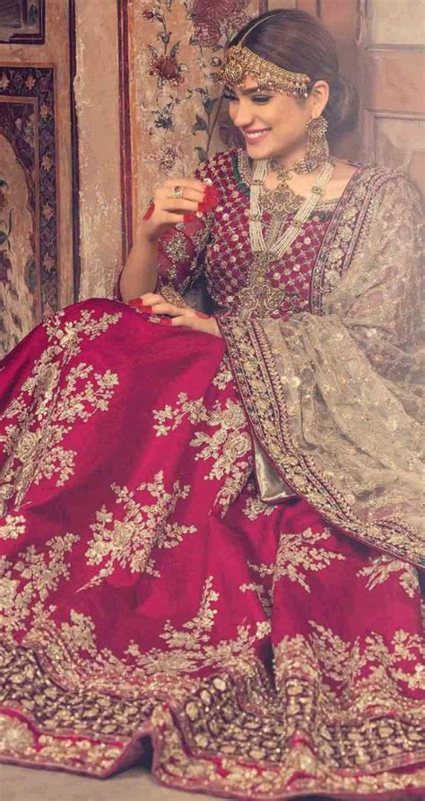 Pakistani bridal dresses in red and golden color 20