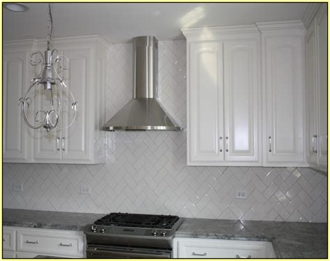 beveled subway tile backsplash herringbone home design ideas
