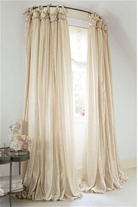 used curtain rods used a curved shower rod for window treatment how
