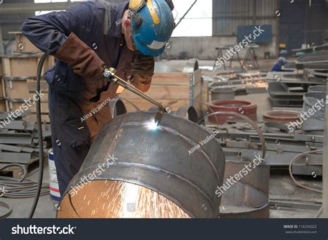 worker cutting steel pipe using metal stock photo 380191102 worker factory cutting steel pipe using stock photo 116334322