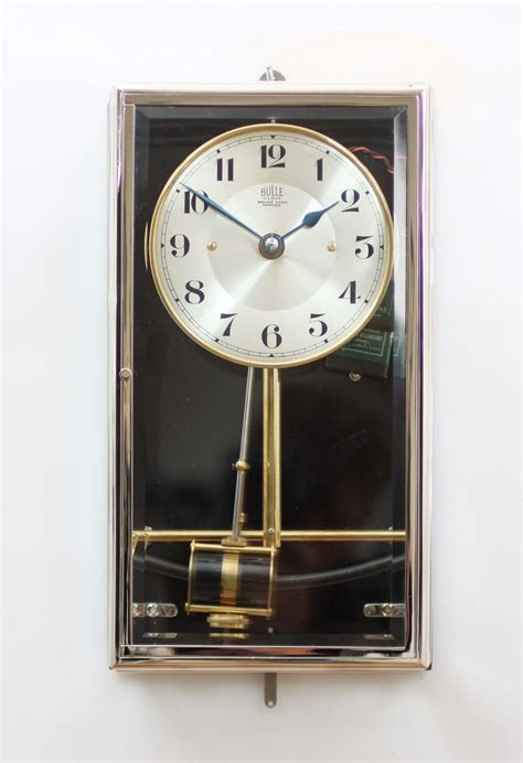 french nickel plated electrical timepiece bulle clock