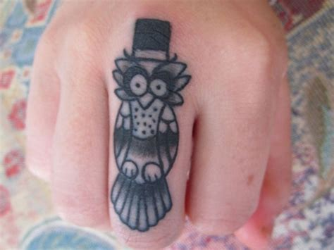 owl tattoo on finger 40 cool owl tattoo design ideas with meanings
