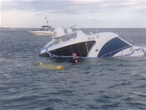 boat sinking in jupiter boat tow crew works overnight to raise sunken yacht in