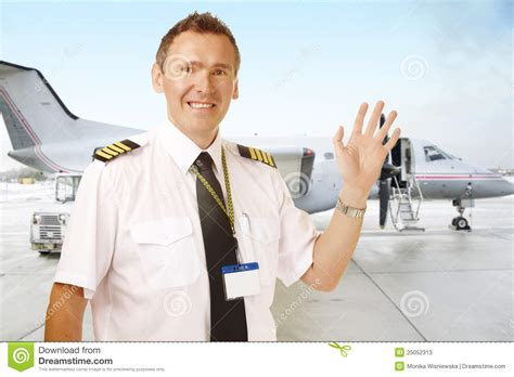 Airline Pilot Background Check Airline Pilot At The Airport Waving Stock Photos Image 25052313