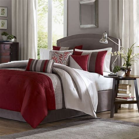 minimalist bedroom with tradewinds red grey striped
