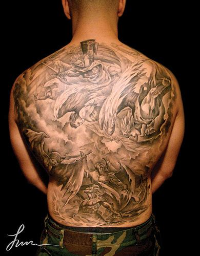 whole back tattoos back of and devils fighting