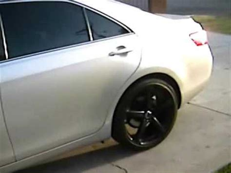 """2008 toyota camry with 20""""rims and carbon fiber door"""