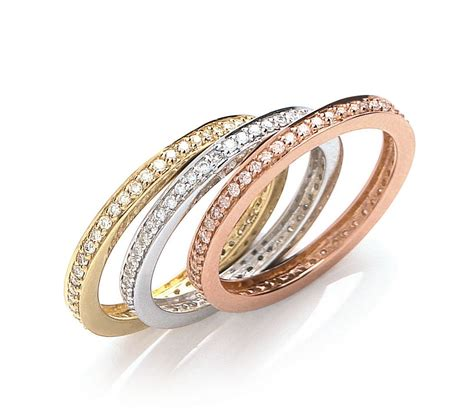 18ct three colour gold 0 68ct eternity ring set