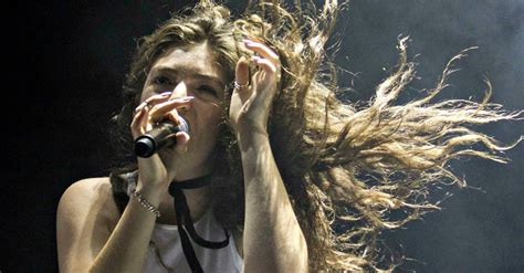 theme song hunger games lorde listen to lorde s haunting hunger games song yellow