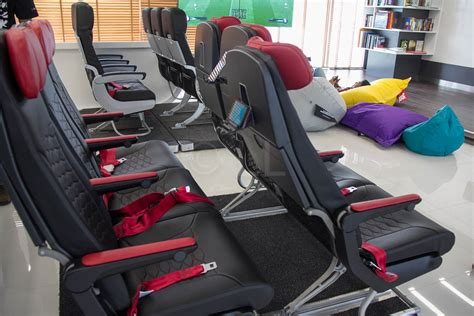 airasia upgrade seat airasia unveils new slimline seats in redq innovation lab