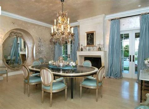 Outstanding dining furniture accented by cool blue colors creating elegant dining room installed