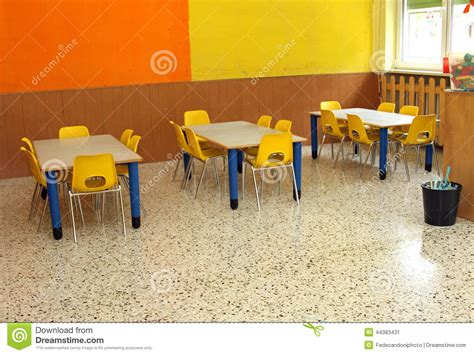 study table for kindergarten classroom with table and small chairs in kindergarten