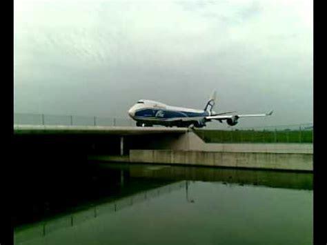 abc air bridge cargo boeing 747 400 freighter crossing overhead schiphol amsterdam airport