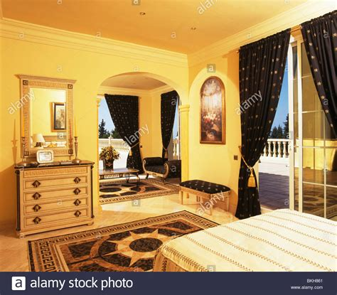 what is curtains in spanish patterned rug and dark blue curtains in yellow spanish