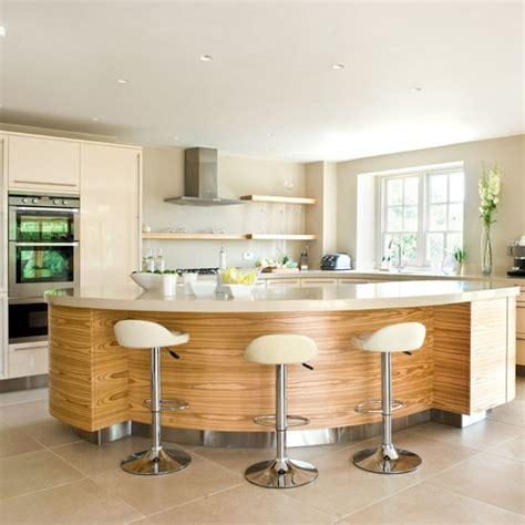 island unit take a tour around a sleek contemporary take a tour around a sleek and glossy cream kitchen