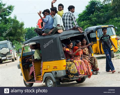 indian car indian auto rickshaw full of people with passengers