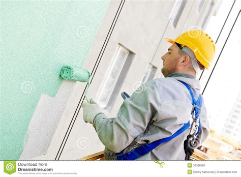 painting work builder facade painter at work stock photo image 35358580