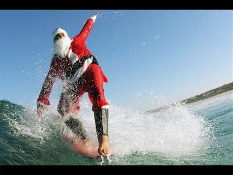 santa on surfboard santa claus prefers surfing no for us