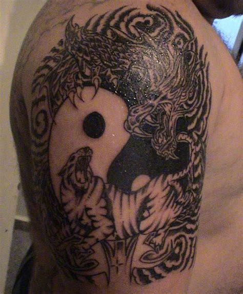 tattoo dragon and tiger meaning yin yang dragon and tiger tattoo on half sleeve yin yang