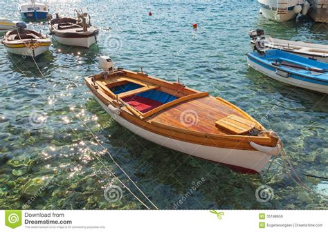 wooden fishing boats float in adriatic sea stock image - Boat Float Prices