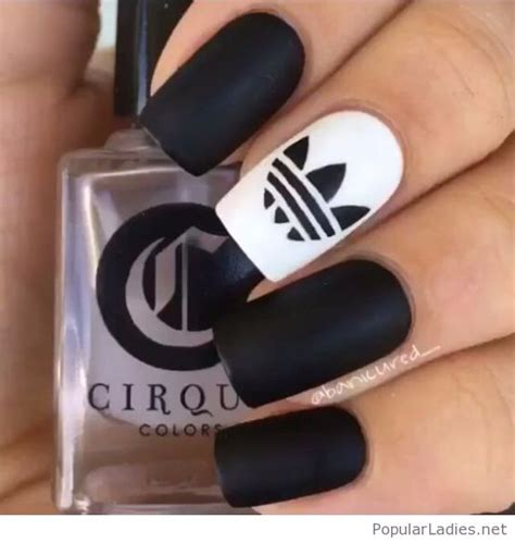 matte black and white nails design with a nice sign idea