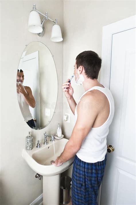 shaving bathroom young man in bathroom shaving stock image image 12621681