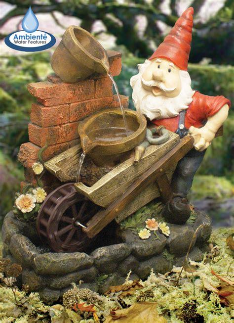 gnome  wheelbarrow water feature  spinning wheel