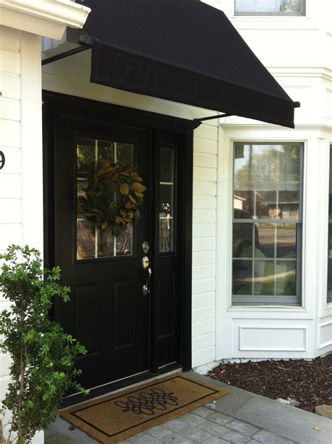 Small Awnings Doors by Black Door Black Awning And White Siding Are A Classic