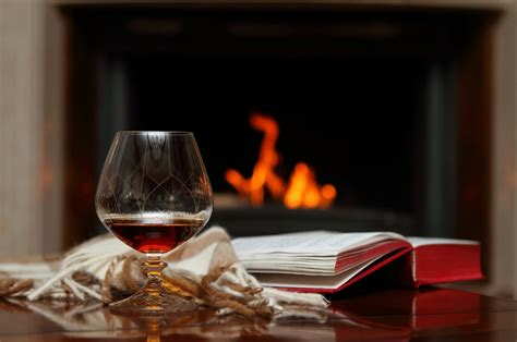 Fireplace Book by Fireplace Book Photo Wine And Book At Cozy Fireplace