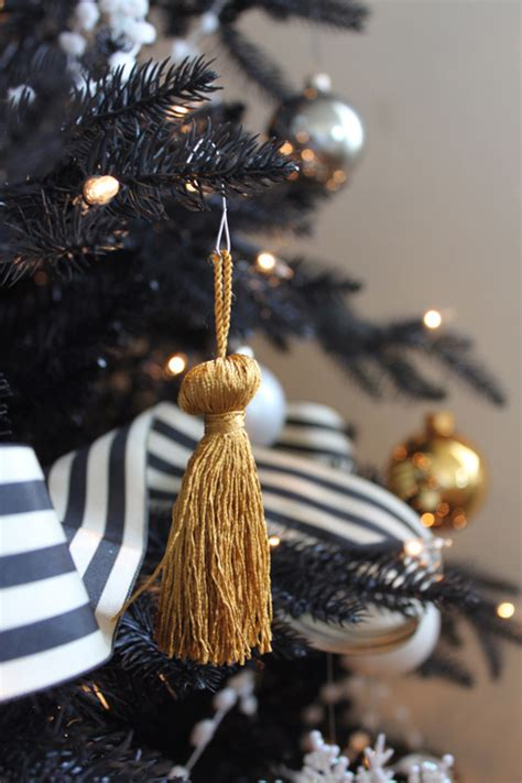 black gold christmas ornaments gold tassel ornaments black and white striped ribbon how via coco kelley holidays